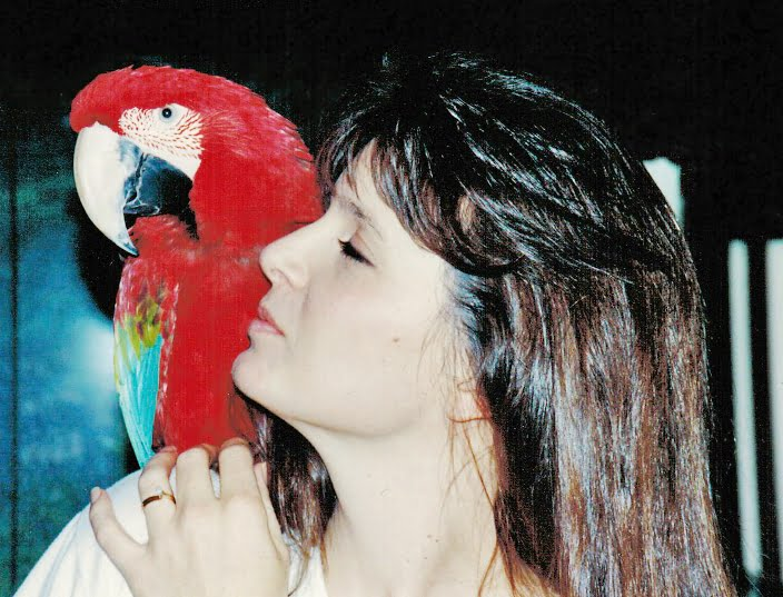 Ceejae Divine and Rocket the macaw