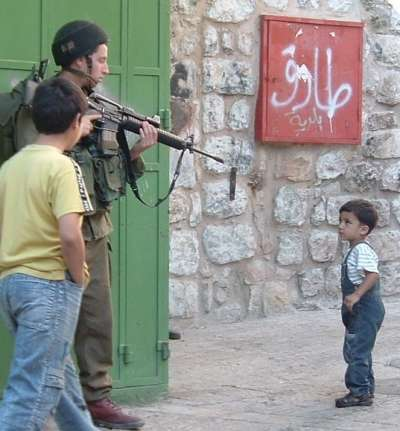 Palestinian child and Isreali soldier