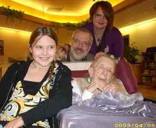 Robert Runte with wife and daughters on his mother's 100th birthday