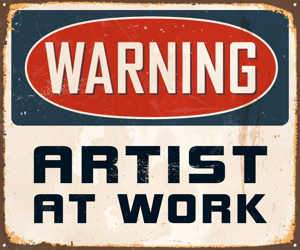 warning sign artist at work